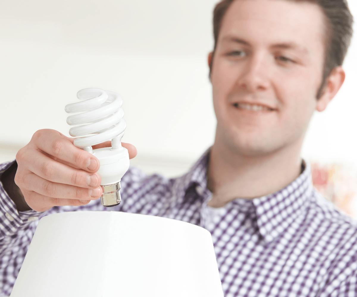 home-hacks-help-save-money-this-winter-man-changing-energy-efficient-lightbulb-image.png