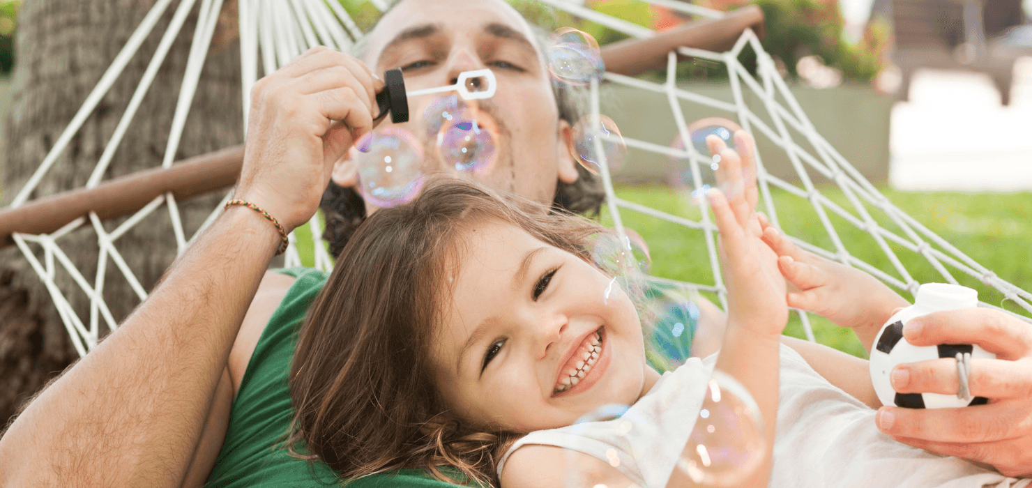 14 At-Home Activities to Spend Time With Your Kids Blowing Bubbles image